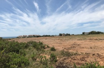 This large flat plot of land would be ideal for a mixed residential/commercial development.  It is flanked on either side by attractive low rise apartment blocks. For a full dossier on the land please contact the agency.